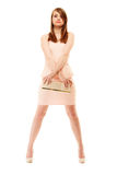 Elegance. Full length of girl in pink dress and with handbag. Female elegance. Full length of attractive girl young woman in elegant light pink dress and with Royalty Free Stock Images