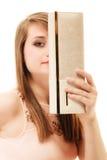 Elegance. Girl covering face with elegant handbag Stock Images