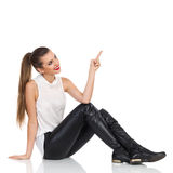 Elegance Girl Sitting And Pointing stock image
