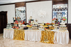 Elegance golden table of different catering at wedding reception Stock Images