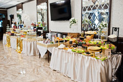 Elegance golden table of different catering at wedding reception Royalty Free Stock Photography