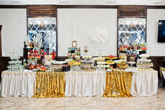 Elegance golden table of different catering at wedding reception Stock Photography