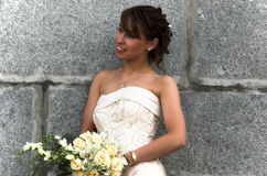 Elegance good-looking bride. With a flower bouquet in park Stock Images