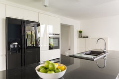 Elegance in kitchen interior. With fridge and marble worktop stock image