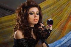 Elegance lady doing make-up Stock Image