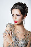 Elegance. Luxurious Good Looking Woman in Dress with Sequins and Jewels Stock Image
