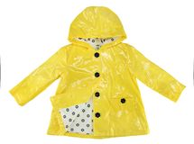 Elegance rain jacket yellow for girl. If it raining day the rain jacket very comfortable and looks very beautiful stock images