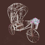 Elegance retro white tricycle with flowers Stock Photos