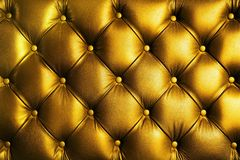 Elegance saturated glossy gold leather texture of sofa chair stock images