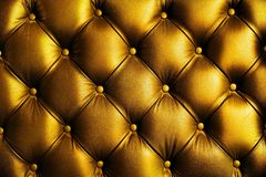 Elegance saturated glossy gold leather texture of sofa chair stock image