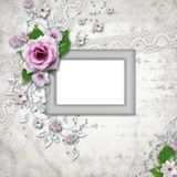 Elegance silver frame for  photo. With rose Stock Images