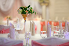 Elegance table set up for wedding. Flowers in the vase. Royalty Free Stock Photography