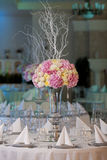 Elegance table set up for wedding. Flowers in the vase. Royalty Free Stock Image