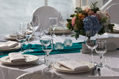 Elegance table set up for wedding in the restaurant. Elegance table set up for wedding in turquoise Stock Image