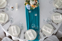 Elegance table set up for wedding in the restaurant. Elegance table set up for wedding in turquoise top view Royalty Free Stock Image