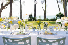 Elegance table set up white, green and yellow flowers theme Stock Photo