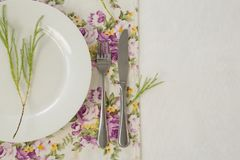 Elegance table setting. Overhead of elegance table setting on white background royalty free stock image