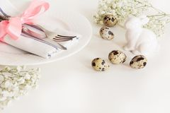 Elegance table setting with pink ribbon and flower on white background. Easter romantic dinner. Top view and copy space Stock Photo