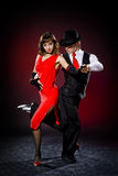 Elegance tango dancers. In action. over dark backgroung Royalty Free Stock Photos