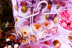Elegance wedding reception table with food and decor. Sweet cackes Stock Photos