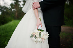 Elegance white wedding bouquet at hand of bride.  Stock Images
