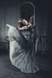 Elegance woman with flying dress in palace room Royalty Free Stock Image