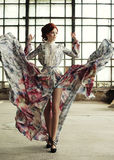 Elegance woman with flying dress in palace room Stock Images