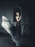 Elegance woman with flying dress in palace room Stock Image