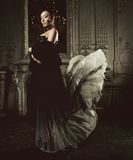 Elegance woman with flying dress in palace room Royalty Free Stock Photo