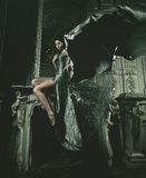 Elegance woman with flying dress in palace room Stock Photography