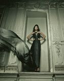 Elegance woman with flying dress in palace room Royalty Free Stock Photography