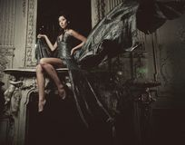 Elegance woman with flying dress in palace room Stock Photo