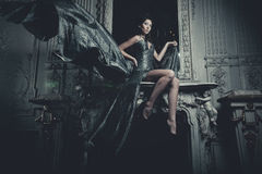Elegance woman with flying dress in palace room Royalty Free Stock Photos