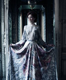 Elegance woman with flying dress in palace room Royalty Free Stock Images