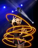 Woman juggler carries out show with hoops. Elegance woman juggler carries out show with hoops Royalty Free Stock Images
