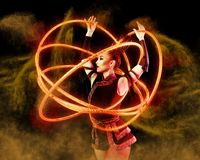 Woman juggler carries out show with hoops. Elegance woman juggler carries out show with hoops Royalty Free Stock Photos