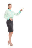 Elegance woman pointing at empty space Stock Image
