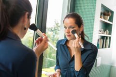 Elegance woman preparation face blush cosmetic brush. Bathroom mirror morning Stock Images