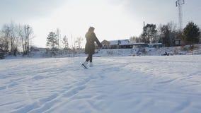 Elegance woman skates on snowy landscape. stock video