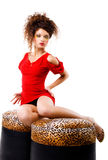Elegance women on the pouffes Royalty Free Stock Image