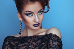 Elegance young adult female with professional make up in studio Stock Image