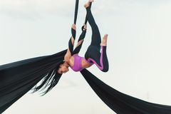 Elegance young beautiful woman dance with aerial silk on a sky background. Fly yoga sport Royalty Free Stock Images