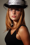 Elegance young woman. With hat Royalty Free Stock Photo