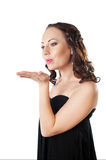 Elegance young woman blowing a kiss Royalty Free Stock Image