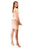 elegancia Integral de muchacha en vestido rosado y con el bolso Fotografía de archivo libre de regalías