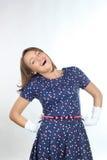 Elegancka kobieta jest ubranym polek kropek suknię, uczucie dobry i taniec w studiu Zdjęcia Royalty Free