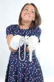 Elegancka kobieta jest ubranym polek kropek suknię, uczucie dobry i taniec w studiu Zdjęcie Stock