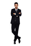Elegancki mężczyzna w czarnym kostiumu na bielu, obraz stock