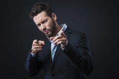 Elegancki mężczyzna wskazuje palce Obraz Stock