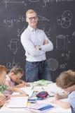 Elegancki, młody nauczyciel matematyki, Zdjęcia Royalty Free